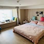 青島藍掌櫃公寓