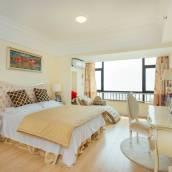 青島萬達東方影都溫馨家庭雙床公寓